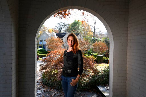 (AP Photo/John Amis). In this Nov. 27, 2019, photo, Georgia Tech professor Kim Cobb poses for a photo at her home in Atlanta. Some climate scientists and activists, including Cobb, are limiting their flying, their consumption of meat and their overall ...