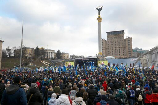 (AP Photo/Efrem Lukatsky). Activists attend a rally in central Kyiv, Ukraine, Sunday, Dec. 8, 2019. Several thousand people rallied Sunday in the Ukrainian capital of Kyiv to demand that the president defend the country's interests in this week's summi...