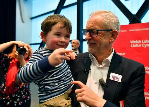 (Ben Birchall/PA via AP). Labour Leader Jeremy Corbyn interacts with three years old Noa Williams Roberts after addressing a members' rally at Bangor University, while on the General Election campaign trail in Bangor, Wales, Sunday, Dec. 8, 2019. Brita...