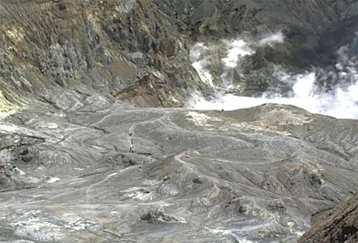 (GNS Science via AP). In this image released by GeoNet, tourists can be seen on a trail near the volcano's crater Monday, Dec. 9, 2019, on White Island, New Zealand. Prime Minister Jacinda Ardern says about 100 tourists were on or near White Island whe...
