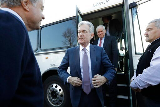 (AP Photo/Steven Senne, File). FILE - In this Nov. 25, 2019, file photo Federal Reserve Board Chair Jerome Powell, center, steps off a bus and greets people during tour of East Hartford, Conn. On Wednesday, Dec. 11, the Federal Reserve issues a stateme...