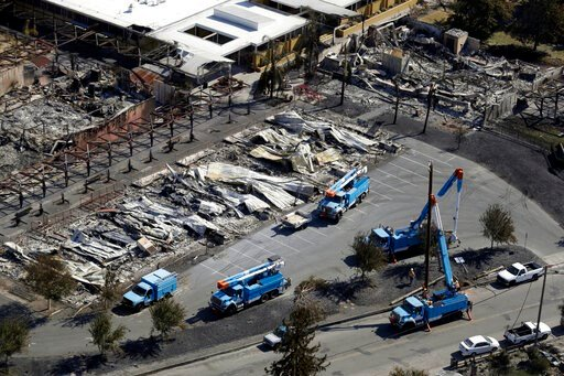 (AP Photo/Marcio Jose Sanchez, File). FILE - In this Oct. 14, 2017, file photo, Pacific Gas & Electric crews work on restoring power lines in a fire ravaged neighborhood in an aerial view in the aftermath of a wildfire in Santa Rosa, Calif. Pacific...