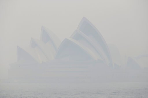 (AP Photo/Rick Rycroft). Thick smoke from wildfires shroud the Opera House in Sydney, Australia, Tuesday, Dec. 10, 2019. Hot dry conditions have brought an early start to the fire season.