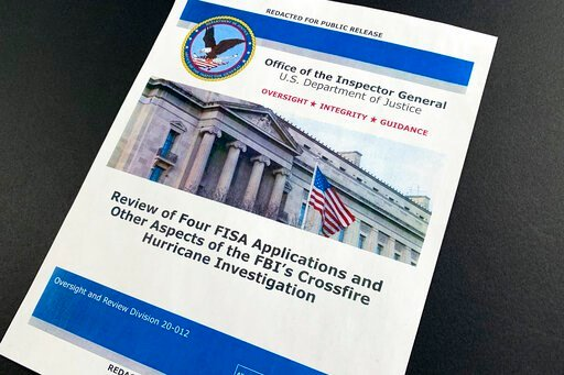 (AP Photo/Jon Elswick). The cover page of the report issued by the Department of Justice inspector general is photographed in Washington, Monday, Dec. 9, 2019. The report on the origins of the Russia probe found no evidence of political bias, despite p...