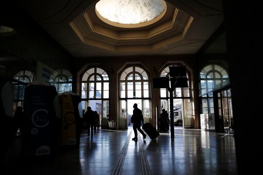 (AP Photo/Francois Mori). A man pulls his luggage at the Gare de l'Est train station Tuesday, Dec. 10, 2019 in Paris. Only about a fifth of French trains ran normally Tuesday, frustrating tourists finding empty train stations, and most Paris subways we...