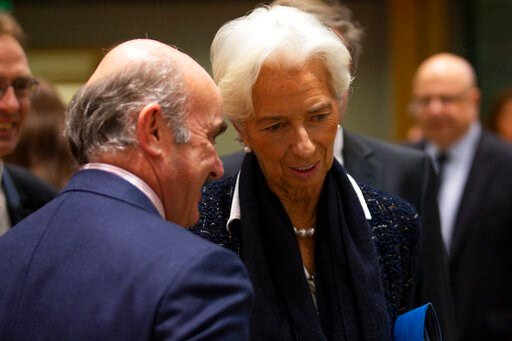 (AP Photo/Francisco Seco). New President of European Central Bank Christine Lagarde, right, talks to European Central Bank Vice President Luis de Guindos during a Finance Ministers Eurogroup meeting at the European Council headquarters in Brussels, Fri...
