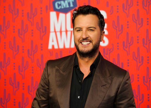 (AP Photo/Sanford Myers, File). FILE - In this June 5, 2019 file photo, Luke Bryan arrives at the CMT Music Awards at the Bridgestone Arena in Nashville, Tenn. A Tennessee wildlife official says a nonnative red stag that was shot and killed last week b...