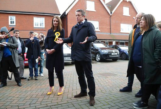 (Gareth Fuller/PA via AP). In this photo dated Saturday, Dec. 7, 2019, British actor Hugh Grant poses for a photo with Liberal Democrats Party election candidate Monica Harding, during an election campaign visit in the Esher and Walton constituency, Wa...