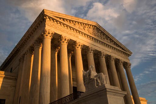 (AP Photo/J. Scott Applewhite, File). FILE - In this Oct. 10, 2017, file photo, the Supreme Court in Washington, at sunset. The Supreme Court has left in place a Kentucky law requiring doctors to perform ultrasounds and show fetal images to patients be...