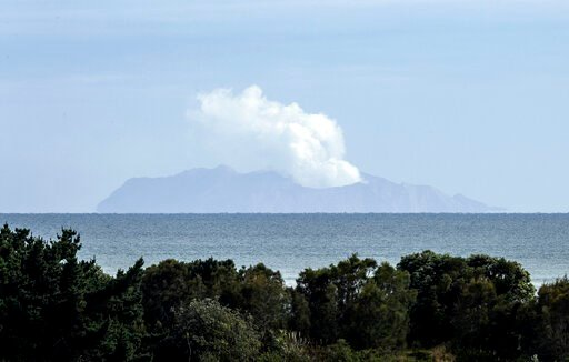 (AP Photo/Mark Baker). Plumes of steam rise above White Island off the coast of Whakatane, New Zealand, Wednesday, Dec. 11, 2019. Survivors of a powerful volcanic eruption in New Zealand on Monday Dec. 9 ran into the sea to escape the scalding steam an...