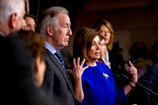 (AP Photo/Andrew Harnik). House Speaker Nancy Pelosi of Calif., accompanied by Chairman of the House Ways and Means Committee Richard Neal, D-Mass., left, and other House members, speaks at a news conference to discuss the United States Mexico Canada A...
