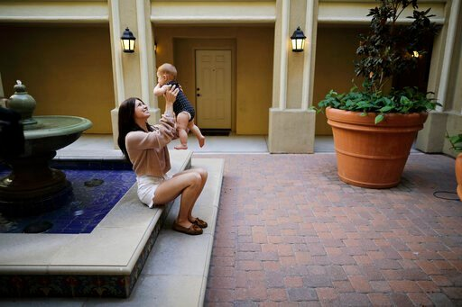 (AP Photo/Gregory Bull,File). FILE - In this Aug. 24, 2018 file photo Keira Sumimoto plays with her daughter, in Irvine, Calif. Sumimoto, who used marijuana briefly for medical reasons while pregnant and breastfeeding, says her daughter is healthy and ...