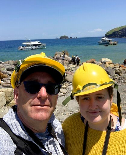 (Lillani Hopkins via AP). In this Monday, Dec. 9, 2019, photo provided by Lillani Hopkins, Lillani Hopkins pictured with her father Geoff prior to the eruption on White Island off the coast of Whakatane, New Zealand. Lillani Hopkins was feeling seasick...
