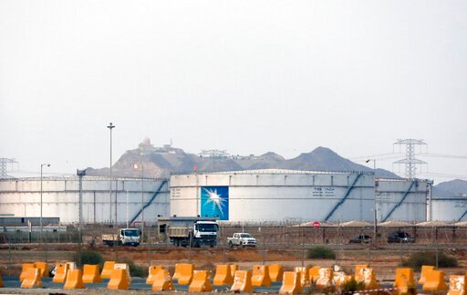 (AP Photo/Amr Nabil, File). FILE - This Sept. 15, 2019 file photo, shows storage tanks at the North Jiddah bulk plant, an Aramco oil facility, in Jiddah, Saudi Arabia. Saudi Arabia's state-owned oil company Aramco on Thursday, Dec. 5, 2019, set a share...