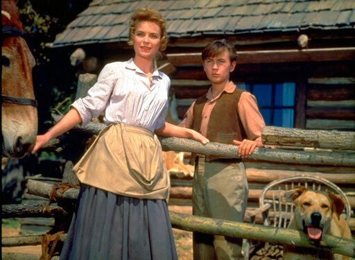 "(Disney via AP). This image released by Disney shows Dorothy McGuire, left, and Tommy Kirk in a scene from the 1957 classic ""Old Yeller."" The film is among 25 films to be added to the National Film Registry of the Library of Congress."