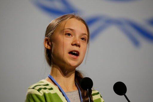 (AP Photo/Paul White). Swedish climate activist Greta Thunberg addresses plenary of U.N. climate conference during with a meeting with leading climate scientists at the COP25 summit in Madrid, Spain, Wednesday, Dec. 11, 2019. Thunberg is in Madrid wher...