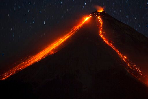 """(AP Photo/Moises Castillo, File). FILE - In this Jan. 4, 2016, file photo, the Volcano of Fire releases lava, seen from Escuintla, Guatemala. In Spanish it's known as """"El Volcan del Fuego."""""""
