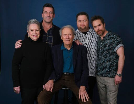 "(AP Photo/Chris Pizzello). This Dec. 5, 2019 photo shows director Clint Eastwood, center, posing with cast members, from left, Kathy Bates, Jon Hamm, Paul Walter Hauser and Sam Rockwell during a portrait session to promote their film ""Richard Jewell"" a..."