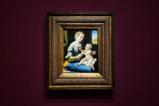 (AP Photo/Markus Schreiber). The painting 'Madonna of the Pinks' of Renaissance artist Raphael from London's National Gallery is on display at an exhibition at the Gemaeldegalerie in Berlin, Wednesday, Germany, Dec. 11, 2019. Berlin is opening the firs...