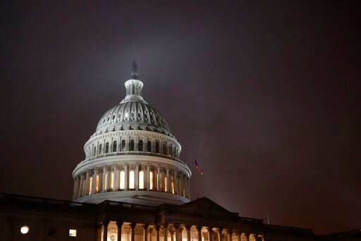 (AP Photo/Patrick Semansky, File). FILE - In this Dec. 9, 2019, file photo mist rolls over the U.S. Capitol dome on Capitol Hill in Washington. On Wednesday, Dec. 11, the Treasury Department releases federal budget data for November.
