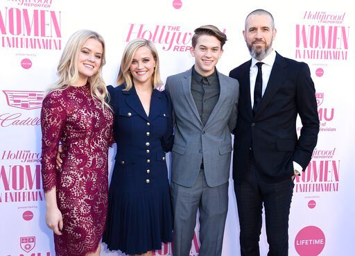 (Photo by Jordan Strauss/Invision/AP). Ava Phillippe, from left, Reese Witherspoon, Deacon Phillippe and Jim Toth arrive at The Hollywood Reporter's Women in Entertainment Breakfast Gala on Wednesday, Dec. 11, 2019, in Los Angeles.