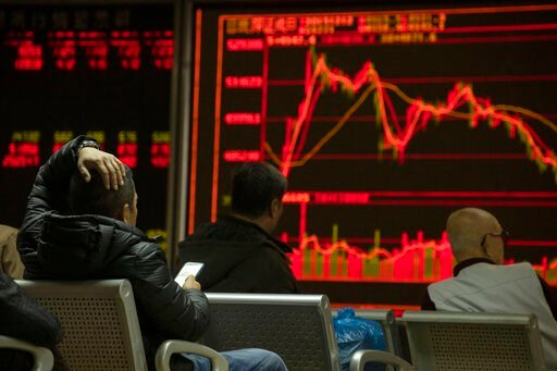 (AP Photo/Ng Han Guan). Investors monitors stock prices at a brokerage in Beijing on Thursday, Dec. 12, 2019. Asian shares are mixed after a wobbly day on Wall Street following the Federal Reserve announcement that it would leave interest rates unchang...