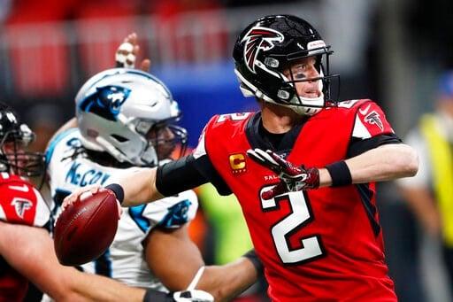 (AP Photo/John Bazemore). Atlanta Falcons quarterback Matt Ryan (2) works in the pocket against the Carolina Panthers during the first half of an NFL football game, Sunday, Dec. 8, 2019, in Atlanta.