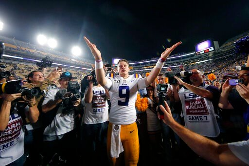 (AP Photo/Gerald Herbert, File). FILE - In this Nov. 30, 2019, file photo, LSU quarterback Joe Burrow (9) gestures thanks to the student section after playing his last game in Tiger Stadium, an NCAA college football game against Texas A&M, in Baton...