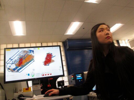 (AP Photo/Wayne Parry). In this Dec. 12, 2019 photo, Bijia Chen, an engineer with a technology company that won a federal contest to find new or better ways to scan incoming mail for illegal opioid shipments, demonstrates how the computer analysis work...