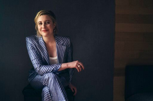 """(Photo by Victoria Will /Invision/AP). In this Tuesday, Dec. 10, 2019, photo, actor and director, Greta Gerwig, poses for a portrait in New York. Gerwig's film, """"Little Women,"""" releases in the U.S. on Dec. 25."""