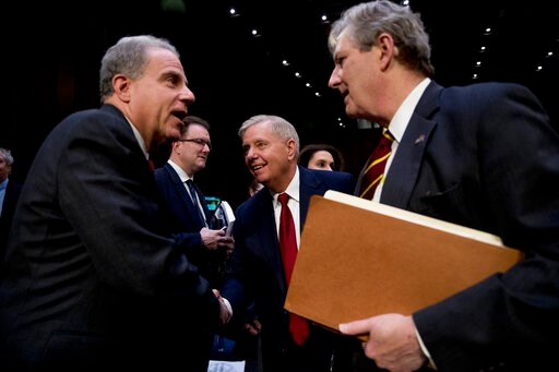 (AP Photo/Andrew Harnik). Department of Justice Inspector General Michael Horowitz, left, speaks with Chairman Lindsey Graham, R-S.C., center, and Sen. John Kennedy, R-La., right, after testifying at a Senate Judiciary Committee hearing on the Inspecto...