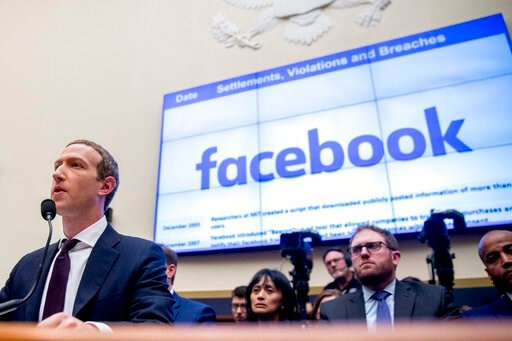(AP Photo/Andrew Harnik, File). File-This Oct. 23, 2019, file photo shows Facebook CEO Mark Zuckerberg testifying  before a House Financial Services Committee hearing on Capitol Hill in Washington. Facebook's stock dropped almost 3% in regular trading ...