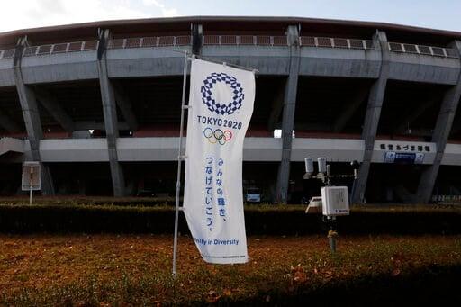 (AP Photo/Jae C. Hong). A Tokyo 2020 banner stands in front of the Azumi Baseball Stadium, a venue for baseball and softball at the Tokyo 2020 Olympics, Saturday, Nov. 30, 2019, in Fukushima, Fukushima prefecture, Japan. The torch relay for the Tokyo O...