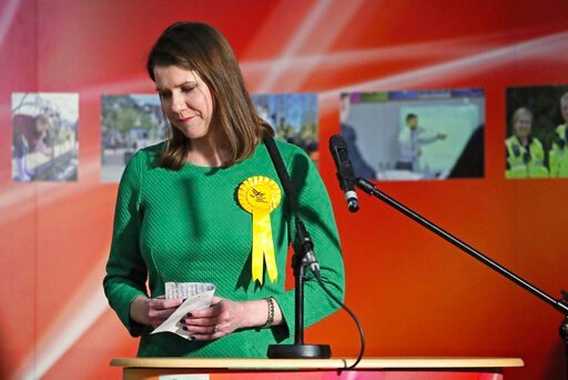 (Jane Barlow/PA via AP). Lib Dem leader Jo Swinson, second right, reacts as she loses her East Dumbartonshire constituency, during the count at the Leisuredome, Bishopbriggs, Scotland, Friday Dec. 13, 2019.