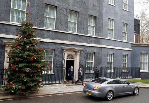 (AP Photo/Thanassis Stavrakis). Britain's Prime Minister Boris Johnson leaves number 10 Downing Street in London, Friday, Dec. 13, 2019 on his way to meet Queen Elizabeth II to seek her approval to form a new government. Prime Minister Boris Johnson's ...