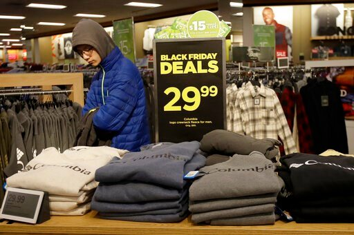 (AP Photo/Jeff Chiu, File). FILE- In this Nov. 29, 2019, file photo customers shop at a Kohl's store in Colma, Calif. On Friday, Dec. 13, the Commerce Department releases U.S. retail sales data for November.