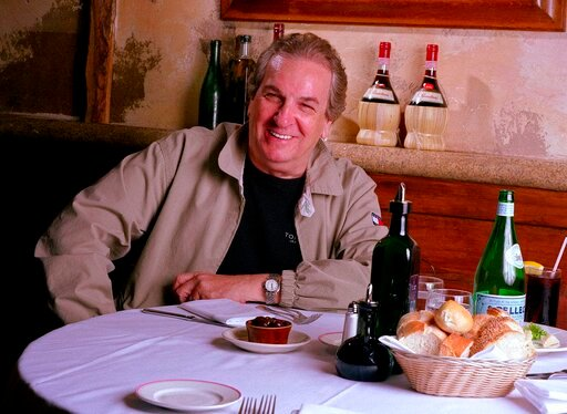 "(AP Photo/Jim Cooper, File). FILE - In this July 28, 2001 file photo, Danny Aiello poses for a photo at Gigino restaurant in New York. Aiello, the blue-collar character actor whose long career playing tough guys included roles in ""Fort Apache, the Bron..."
