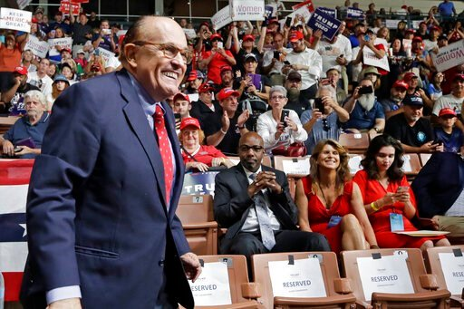 (AP Photo/Elise Amendola, File). FILE - In this Aug. 15, 2019, file photo, former New York City Mayor Rudy Giuliani smiles as he arrives to President Donald Trump's campaign rally in Manchester, N.H. Federal prosecutors are planning to interview an exe...