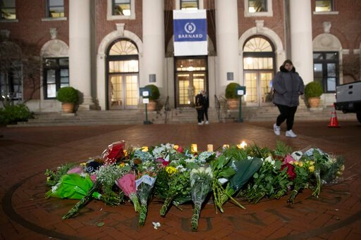(AP Photo/Mary Altaffer). A woman walks past a make-shift memorial for Tessa Majors inside the Barnard College campus, Thursday, Dec. 12, 2019, in New York. Majors, a 18-year-old Barnard College freshman from Virginia, was fatally stabbed in a park nea...