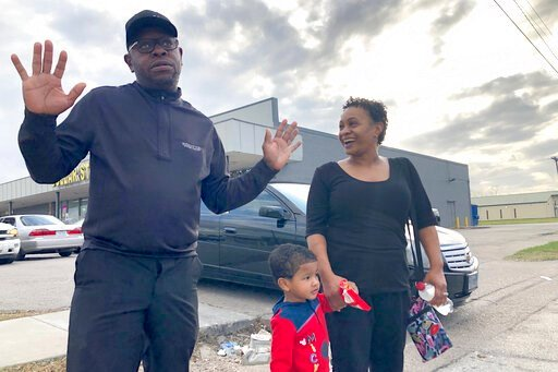 """(AP Photo/ John L. Mone). In this Tuesday, Dec. 10, 2019, Rapper turned political candidate, Brad """"Scarface"""" Jordan, left, visits with voter Michele Lemon and her son outside of an early voting location in the Sunnyside neighborhood of Houston, Texas. ..."""