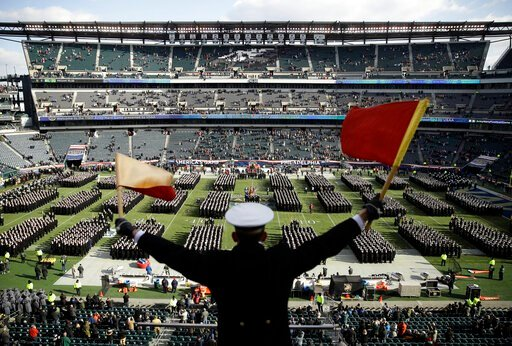 (AP Photo/Matt Rourke, File). FILE - In this Dec. 8, 2018, file photo, Navy Midshipman Frey Pankratz singles his classmates as they march onto the field ahead of an NCAA college football against the Army in Philadelphia. The 120th Army-Navy game is set...