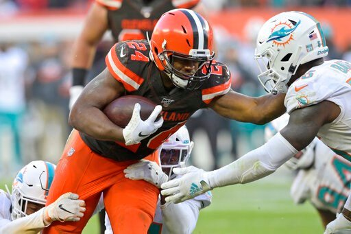 (AP Photo/David Richard). Cleveland Browns running back Nick Chubb (24) rushes for a 5-yard touchdown during the second half of an NFL football game against the Miami Dolphins, Sunday, Nov. 24, 2019, in Cleveland.