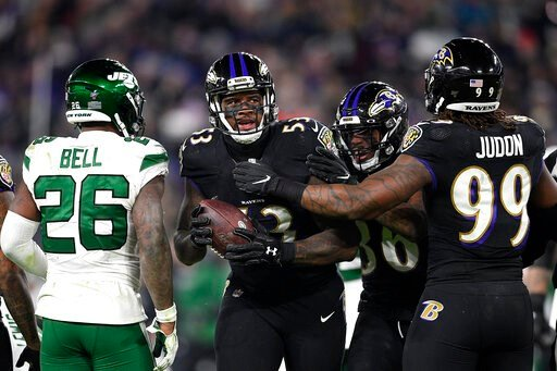 (AP Photo/Nick Wass). Baltimore Ravens defensive end Jihad Ward, center, is congratulated by teammates after recovering a fumble by New York Jets quarterback Sam Darnold, not visible, during the second half of an NFL football game, Thursday, Dec. 12, 2...