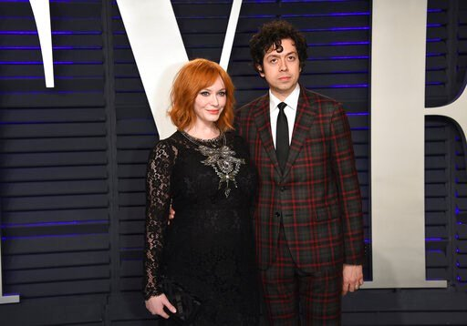 (Photo by Evan Agostini/Invision/AP, File). FILE - In this Feb. 24, 2019 file photo, Christina Hendricks, left, and Geoffrey Arend arrive at the Vanity Fair Oscar Party in Beverly Hills, Calif. Hendricks filed for divorce Friday, Dec. 13,  from her hus...