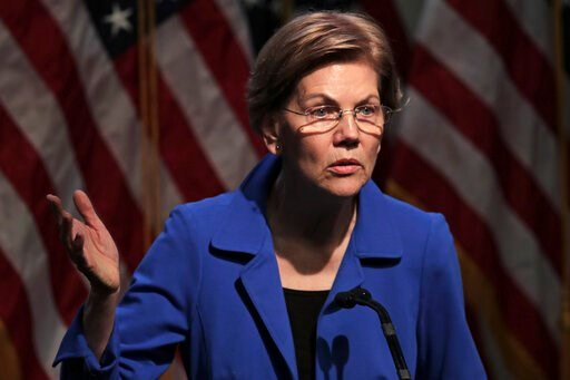 (AP Photo/Charles Krupa). Democratic presidential candidate Sen. Elizabeth Warren, D-Mass., gestures during her address at the New Hampshire Institute of Politics in Manchester, N.H., Thursday, Dec. 12, 2019.