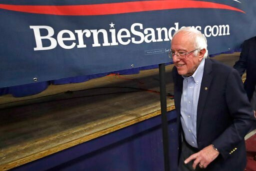 (AP Photo/Elise Amendola). Democratic presidential candidate Sen. Bernie Sanders, D-Vt., leaves after speaking at a campaign event, Friday, Dec. 13, 2019, in Manchester, N.H.