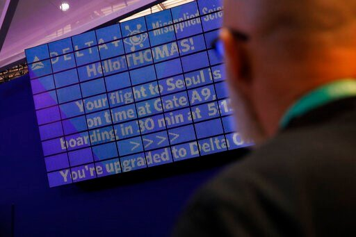 (AP Photo/John Locher). An attendee looks at a screen with information unique to him the parallel reality experience at the Delta Air Lines booth during the CES tech show, Tuesday, Jan. 7, 2020, in Las Vegas. The parallel reality screens are a type of ...