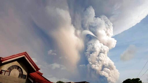 (Jogs Danao/AP Photo). Taal Volcano spews ash and smoke during an eruption as seen from Cavite province, south of Manila, Philippines on Sunday. Jan. 12, 2020.