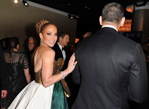 (Richard Shotwell/Invision/AP). Jennifer Lopez, left, and Alex Rodriguez attend the 77th annual Golden Globe Awards at the Beverly Hilton Hotel on Sunday, Jan. 5, 2020, in Beverly Hills, Calif.