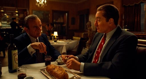 "(Netflix via AP). This image released by Netflix shows Joe Pesci, left, and Robert De Niro in a scene from ""The Irishman."" The film is nominated for a Golden Globe for best motion picture drama."